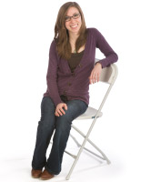 Woman sitting on a folding chair