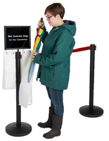 Stanchions with umbrella bags and sign frames