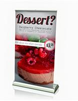 Tabletop retractable banner stand with silver base.