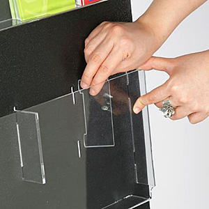 Closeup of a divider getting inserted into an adjustable pocket literature holder