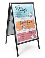 Portable sidewalk sign holder for storefront curbs