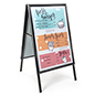 Portable sidewalk sign holder for indoor or outdoor use