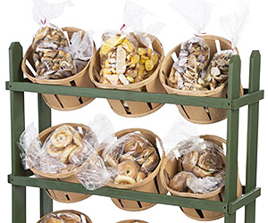 Wooden floor standing basket display shown with bags of bread and bagels