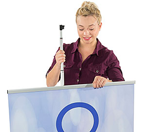 Woman shown setting up a retractable banner stand