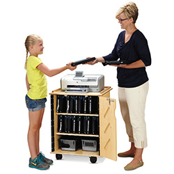 Teacher and student standing next to a tablet charge cart