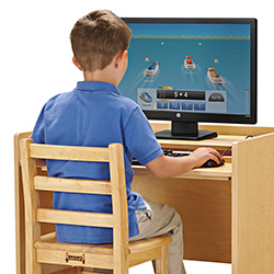 Young boy sitting at a computer workstation