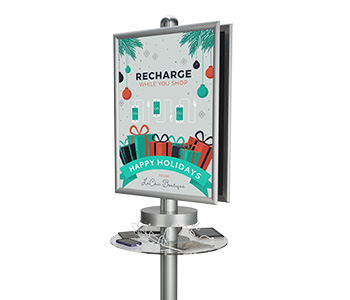 Device charging station with custom printed sign.