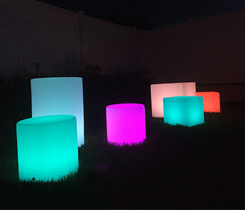 LED furniture illuminated in a dark room.