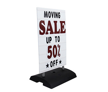 Outdoor roadside letter sign with sturdy base.