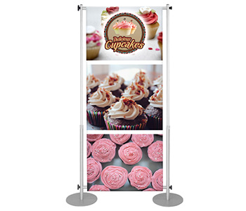 Telescopic banner stand with circular base stability.