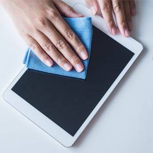 Person Cleaning Tablet with Microfiber Cloth