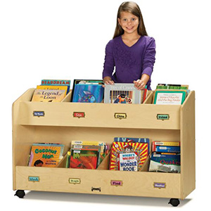 Young girl standing behind a rolling book case for schools and daycare centers