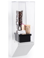 Wedge bottom wall display pedestal showcasing a collectible
