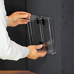 Clear acrylic brochure holder attached to a display board