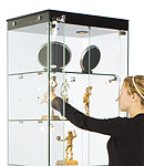 These square tower display cases have a compact width of 15 to 20 inches.