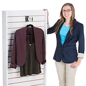 Salesperson standing next to a double-sided slatwall display fixture