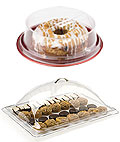 These acrylic domes and covers keep cakes and other pastry protected.