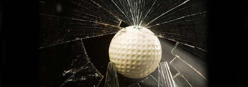 Golf Ball Breaks Standard Glass