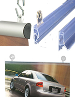Hanging posters from the ceiling are easy with these metal or plastic rails.