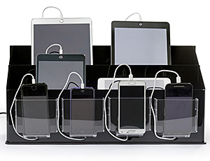 A desktop charge station shown with iPads and cell phones plugged in