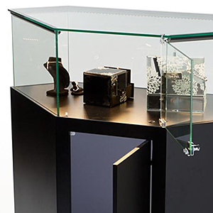 Rear view of a jewelry display counter showing swing-open access doors
