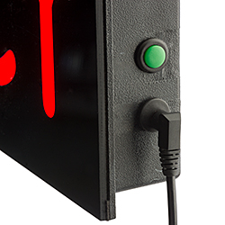 Closeup of an open closed sign showing power plug and on/off button