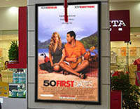 lighted movie poster frames advertise up-coming releases