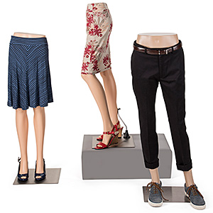 Grouping of three mannequin leg forms with clothing
