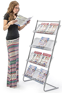 Woman reading a catalog from a metal literature stand