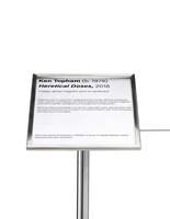 Museum barrier signage plate holds artwork labels
