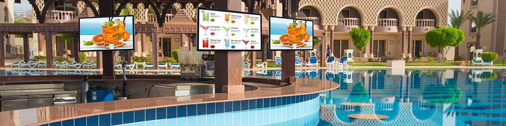 Hotel Resort Pool with Exterior-Rated Digital Advertising Screens Mounted Inside the Bar