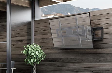 A hotel's swim-up pool bar shown with drink menus on digital screens