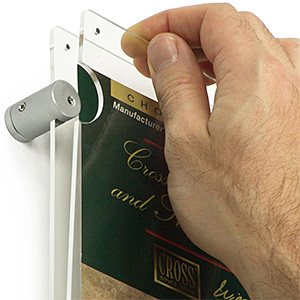 Closeup of a plexiglass poster frame with wall mount standoffs and magnetic enclosure