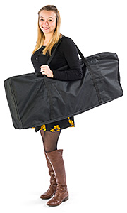Girl carrying a portable trade show display in a bag