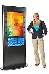 Woman standing next to a floor-standing poster kiosk