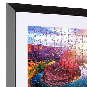 Closeup of a jigsaw puzzle mounted inside a picture frame