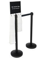 Black stanchions with umbrella bags, sign & black belt