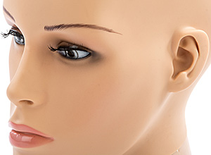 closeup of a realistic female mannequin head with subtle makeup