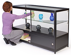 Employee accessing the rear of a display case