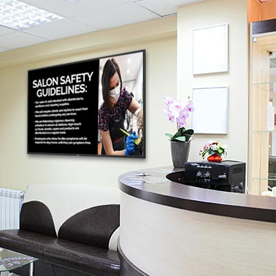 Wall mount digital sign installed inside a beauty salon
