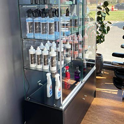 A display case inside a salon stocked with skin and hair products