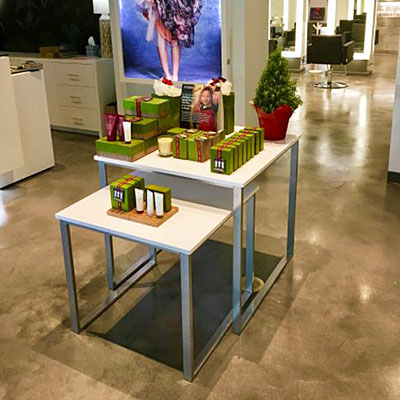 Retail nesting tables displaying hair and skin products in a beauty salon