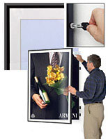 black swinging poster frames