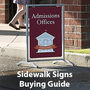 A sidewalk sign shown outside the entrance to a college admissions office