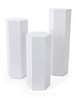 Set of 3 hexagonal gallery pedestals with 30, 36 and 42 inch tall styles