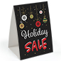 "Table tent with ""Holiday Sale"" with festive messaging"