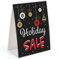 "Seasonal tabletop promo sign with ""holiday sale"" message"