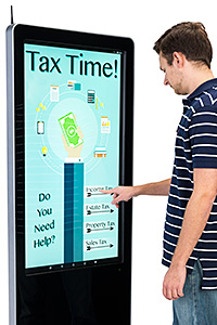 Man Tapping on a Touch Screen Kiosk