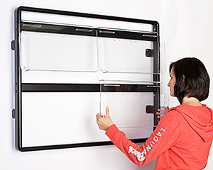 Adding magazine pockets to a wall mounted display frame