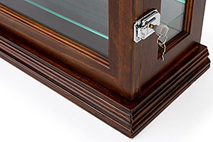 Closeup of a solid wood display case with door lock